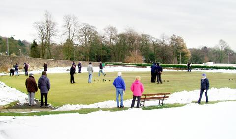 Bowlers spent hours clearing snow from their green