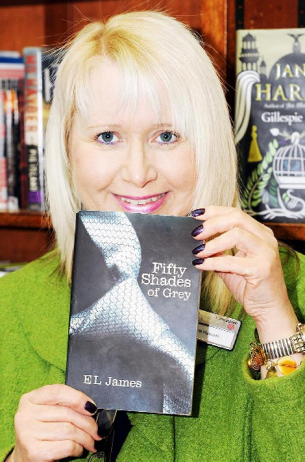 WHAT A THRILLER! Victoria Haworth, district manager for Hyndburn libraries, with 'Fifty Shades of Grey' at Accrington Library.