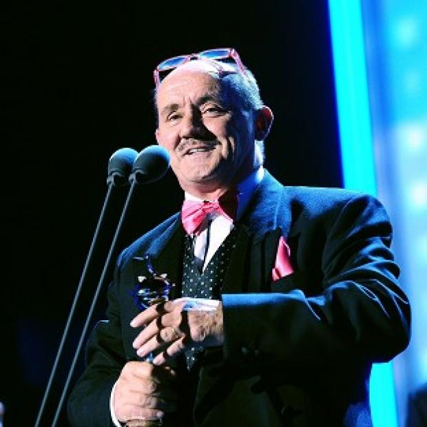 Brendan O'Carroll collects the Best Sitcom award received for Mrs Brown's Boys