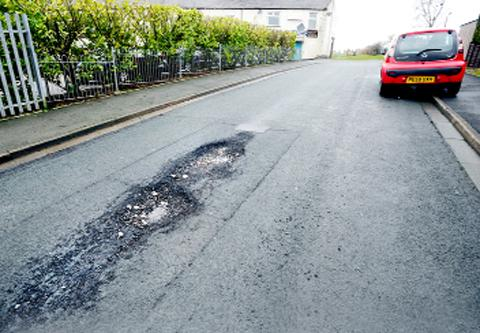 Drivers are facing hazards, including this pothole in Sandiway Drive, Harle Syke