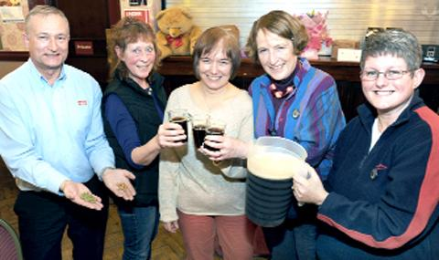 This year's ladies' evening at the Pendle Beer Festival was once again a huge success. Guest speaker Ian Bearpark, production director at Thwaites, is seen with some of the visitors to the event at Colne Muni.