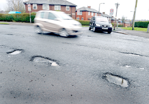 Three of Blackburn's many potholes