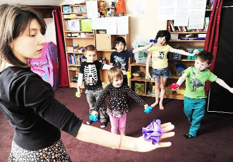 Playgroup leader Nastasya Smirnova with some of the youngsters in her class.