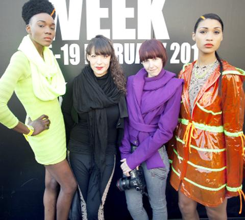 Cassandra, in purple, with some of her models