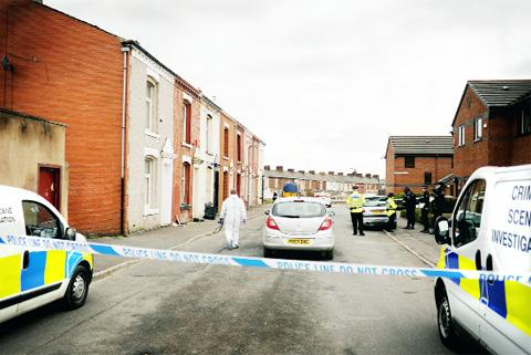 CLUES HUNT Police and forensics teams at the house in Coleridge Street, Blackburn