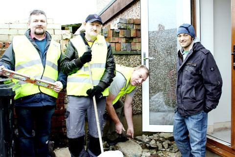 HAPPY TO HELP From left, former Flight Sergeant in the Irish Air Corps Irvine Ferris, ex-Para Tommo Chadwick and VIC manager Bob Elliott with veteran Andrew Worrall hard at work helping to renovate his new home in Clayton-le-Moors