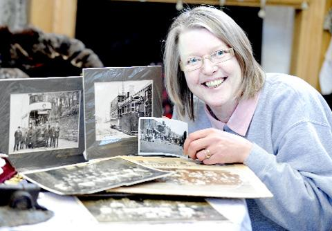 PICTURING PAST Chairman Angela Fryatt at the group's stall in Accrington Market Hall and, below, Accrington Pipe Band parade in June 1959