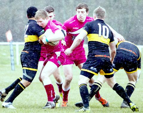 Rossendale's Wynard Van Zyl is halted by Kendal defenders