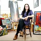 Angela Wakefield with some of her artwork