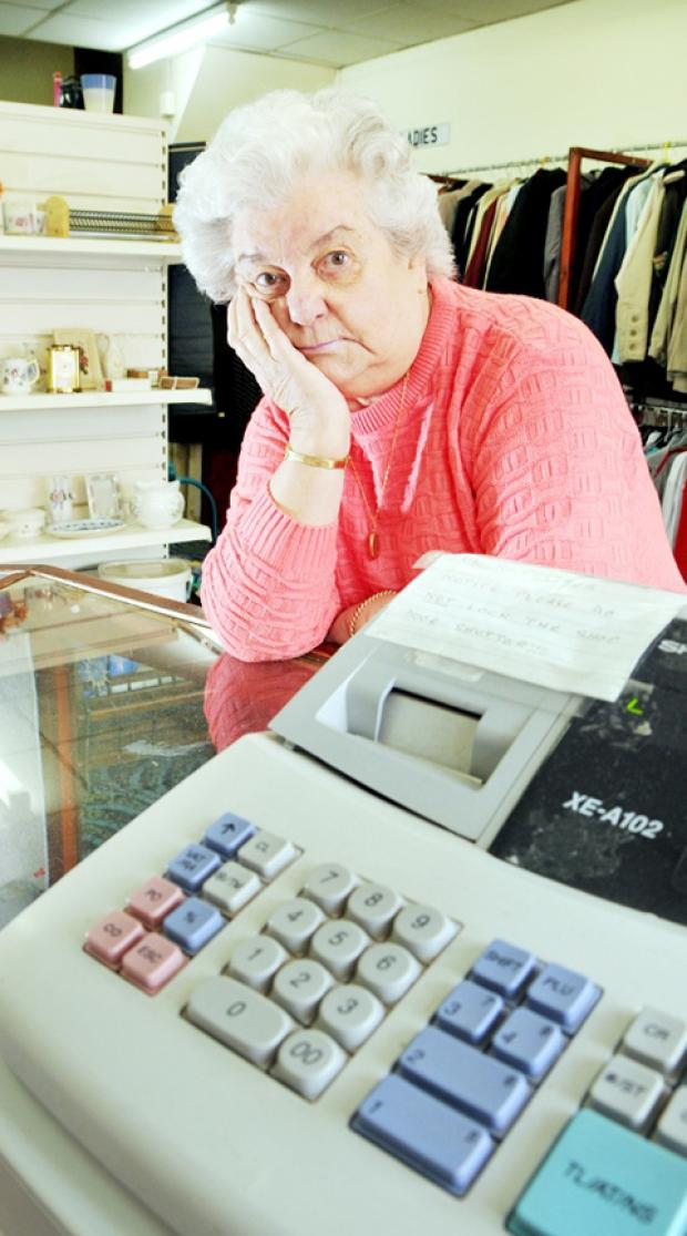 BAFFLED Charity shop volunteer Jennifer Slater says she can't understand why someone would steal a guitar