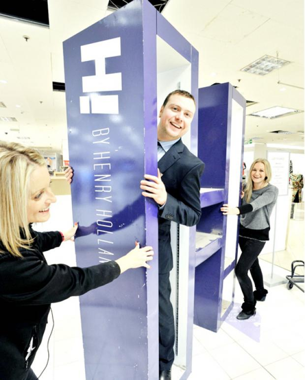 READY to go: manager Matt Cooper helps visual supervisor Lucy Crook and Rachael Varo prepare for the opening of the new-look Debenhams