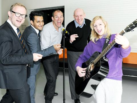 "Rhia Adams, 18, fronts her ""band"", from left, Blackburn with Darwen Council's Andrew Lightfoot, Aemen Ali of the Youth Zone, chairman Andrew Graham and chief exec Peter Little"