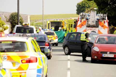 Lancashire Telegraph: Emergency workers at Elton Road, Belthorn