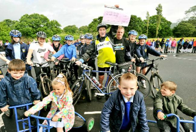 Pupils from St Bede's RC High School were among those who greeted Fred at St Paul's School, Feniscowles, which he visited on his 22 dioceses ride, collecting a £500 cheque