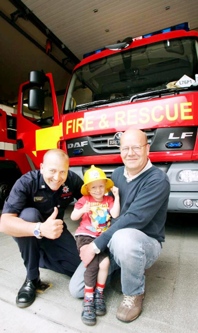 Sam Shaw with crew manager Pete Derbyshire and grandad Phil Speakman, at Darwen Fire Station