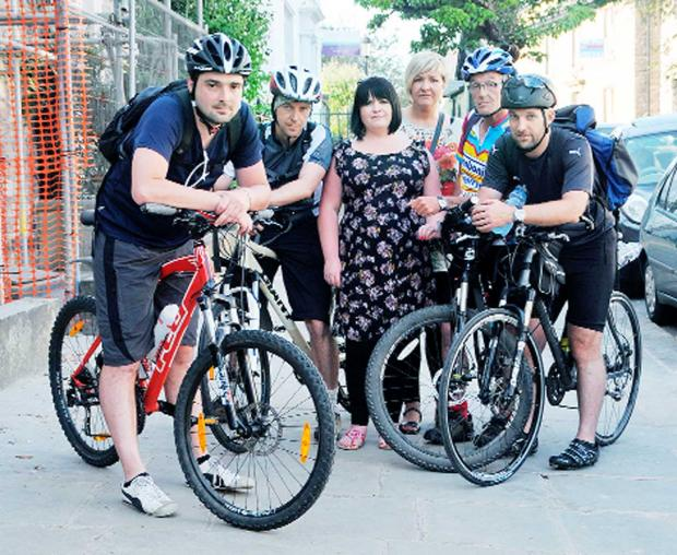 Unhappy members of the Charity Tower to Tower Cycle team in Clitheroe, from left, John Maher, Peter Shuttleworth, Rebecca Winsor), Emma McNally, Paul Maher and Ian Claridge