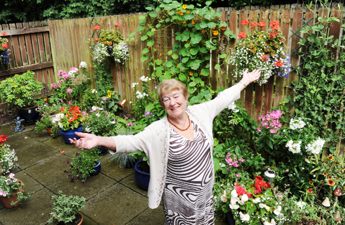 Eileen in her colourful garden