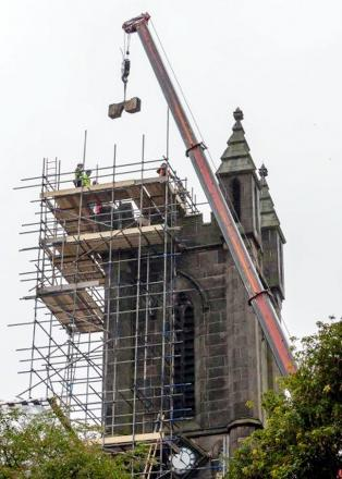 Fallen masonry is removed by a crane from St Andrew's church in Ramsbottom after it was hit by lightning
