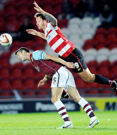 Chris Brown battles for the ball against Burnley