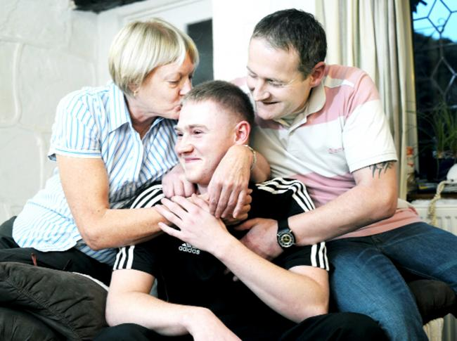 A relieved Dan Rakeshaw with his grandmother Gwen Clarke and dad Nigel  Whalley