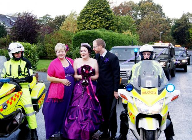 Julie and Adam Bell share their daughter Natalie's surprise on her big day as the two bike escorts and seven 4x4 vehicles from the Northwest response unit arrive