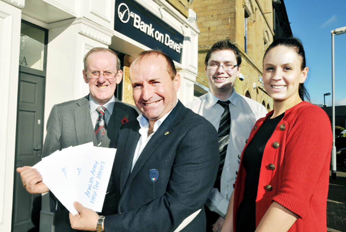 Dave Fishwick with his charity cheques and his staff, from left, David Henshaw, Chris Woods and Rachel Cowan