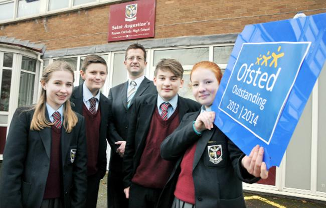 Headteacher Michael Wright celebrates with pupils, from left, Kayley Moore, Harry Lonsdale,  Nathan McCarthy and Laura Rain