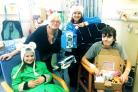 Charlotte Neve, left, and mum Leila,  second right, distributing Lottie Boxes at Leeds Hospital