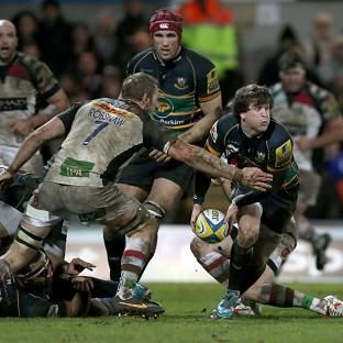 Lee Dickson is tackled by Harlequins' Chris Robshaw at Franklin's Gardens