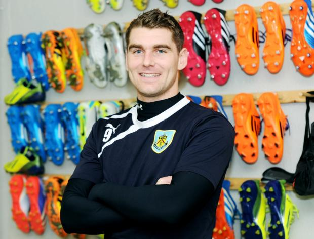 Sam Vokes in the boot room at Burnley's Gawthorpe training ground after signing his new deal