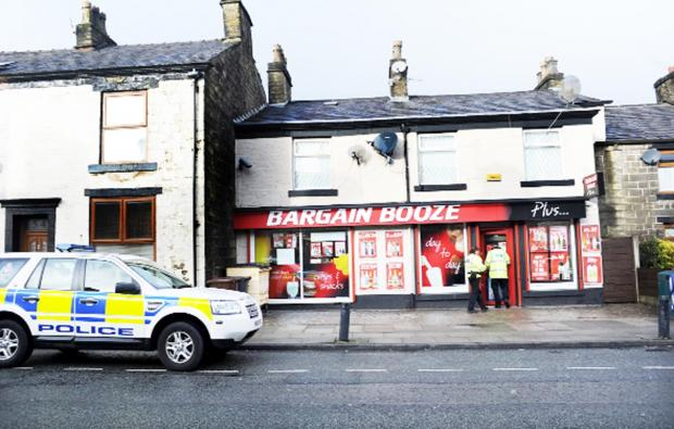 Police at the Bargain Booze shop in Ramsbottom