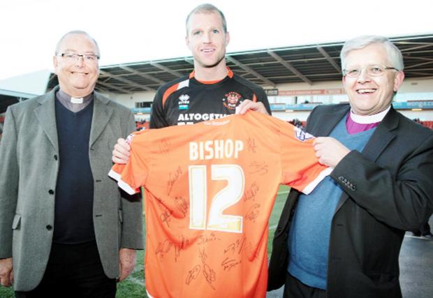 Bishop Julian, right, with Blackpool FC club chaplain the Rev Michael Ward and midfielder Neal Bishop