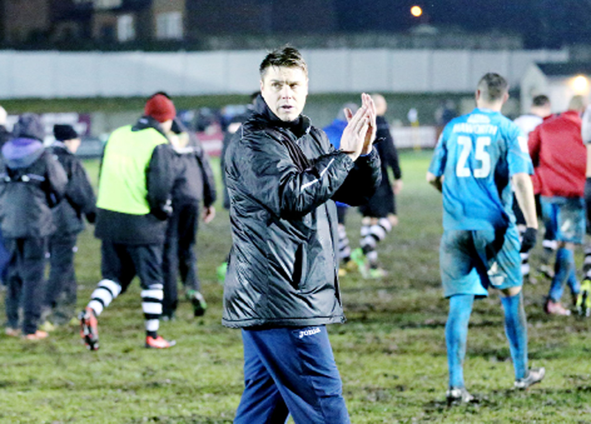 Chorley boss Garry Flitcroft applauds the home fans after his side were denied a place in the last eight of the FA Trophy. The Magpies were