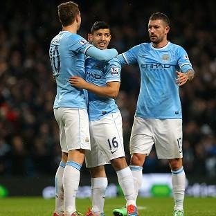 Sergio Aguero, centre, celebrates his return to fitness with a goal