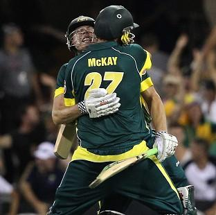James Faulkner, left, and Clint McKay celebrate after helping Australia win the second ODI (AP)