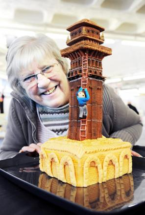 Market trader Eileen Guy admires the cake which is to be raffled for charity