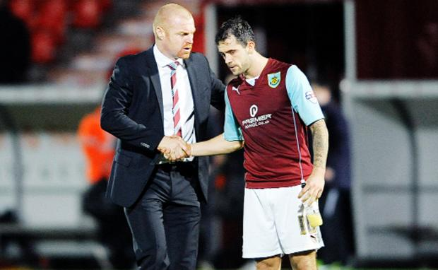 Sean Dyche (left) has got the best out of Danny Ings  this season