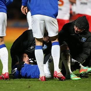 Bryan Oviedo has had surgery after breaking his tibia and fibula against Stevenage