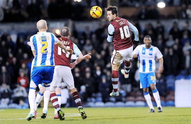 Danny Ings flashes a header across goal