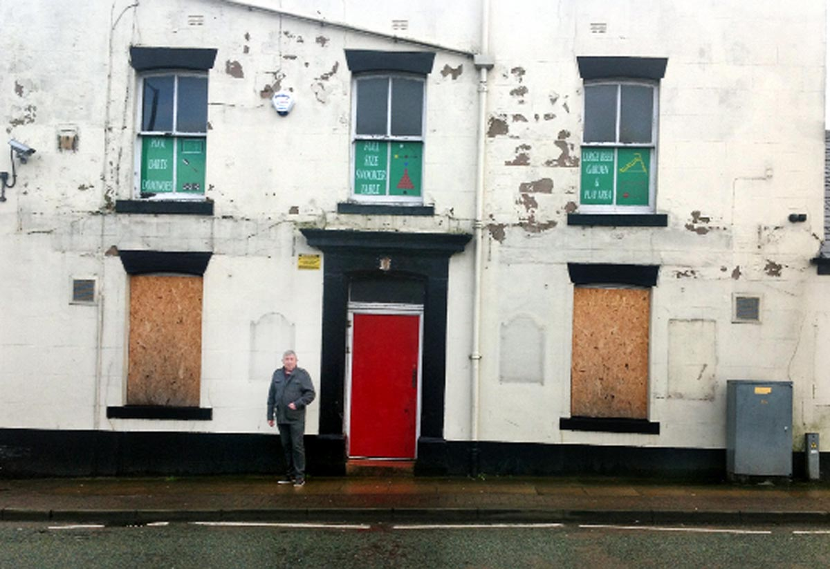 Coun Peter Britcliffe outside Ossy Snooker and Pool, in the former Golden Cross Inn, in Union Road