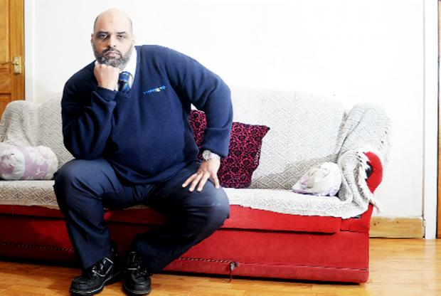 Magistrate Abid Sharif at his Burnley home after the break-in and, inset, broken glass in a door