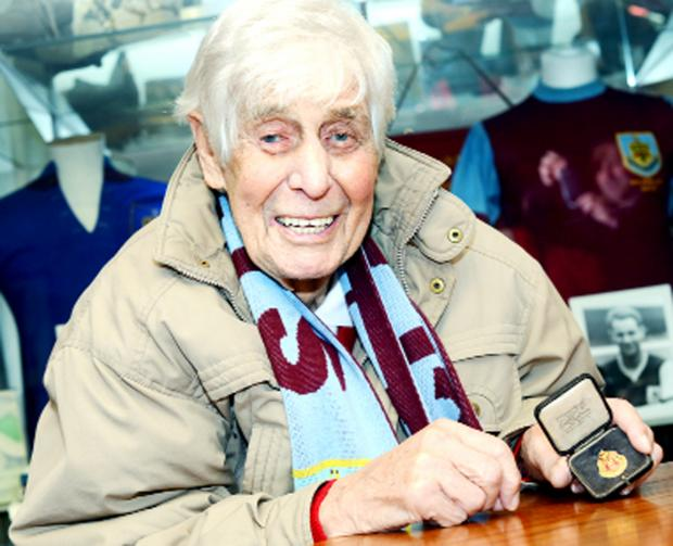 Earle Wilkinson on his visit to Turf Moor with his treasured West Lancashire League Championship medal from 1938/39