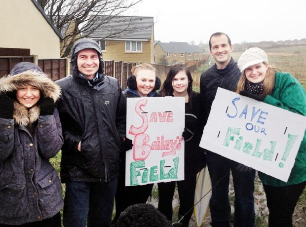MP Jake Berry (second right) with protesters on Bailey's Field