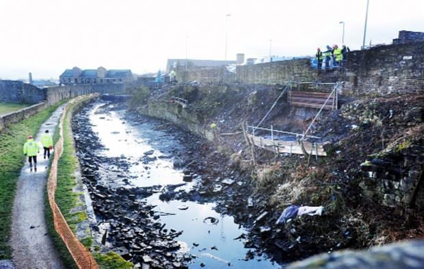 Rocks and debris have collapsed into the canal bed