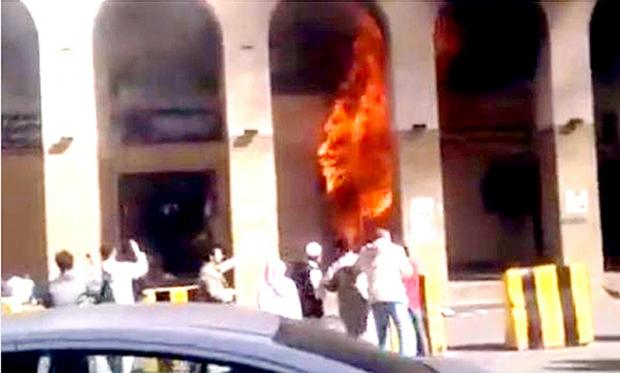 Flames rage through the windows at the Al-Madina Hotel in Saudi Arabia where Mufti Yusuf Bismillah died