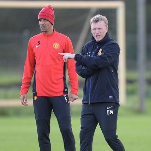 Manchester United manager David Moyes, right, has hit out at speculation surrounding the future of Rio Ferdinand, left.