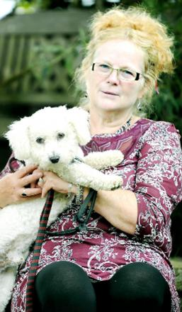 Joy Herd with her Bichon Frise, Marley