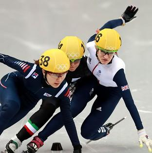 Elise Christie, right, crashes in the 500m final