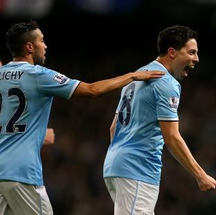 Samir Nasri, right, marked his return to fitness with a goal