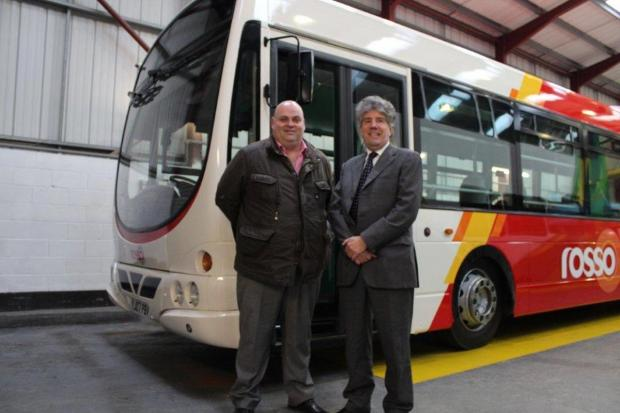 Mr Brian Juffs MD is pictured with Mr Robert Hilton MD of Bus and Coach World Ltd, receiving the first of the nine vehicles.